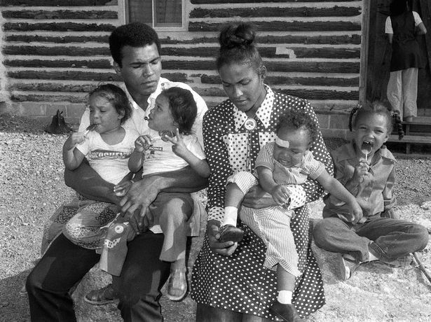Former Heavyweight World Champion Muhammad Ali, is pictured with his wife Belinda and their four children
