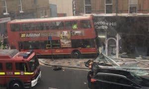Double decker bus crashes into south London shop