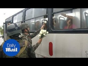 Brazilian military hands out roses for International Women's Day – Daily Mail