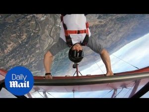 Daredevil dangles from wing of upside down plane before letting go – Daily Mail