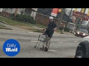 Driver stops to help elderly man cross road – Daily Mail