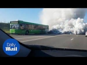Frightening footage of car driving through giant bus smoke cloud – Daily Mail