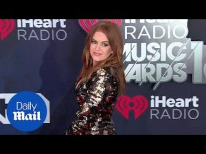 Isla Fisher sparkles in black and gold sequin dress at iHeart – Daily Mail