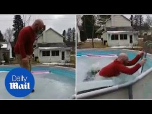 Man walks on frozen pool and falls in – Daily Mail