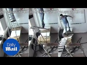 Moment man flies off ladder as it collapses between two tables – Daily Mail