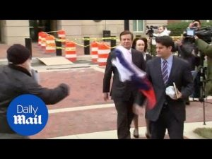 Protester throws Russian flag as Manafort pleads not guilty – Daily Mail