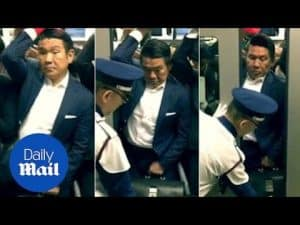 Rush hour in Tokyo: Man has to be pushed into packed tube – Daily Mail