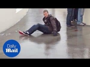 Student have fun sliding down icy bridge after it froze over – Daily Mail